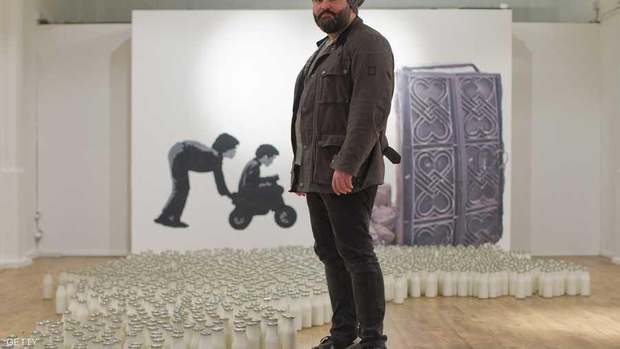 المعرض ينظمه الصليب الأحمر البريطاني، الذي يشارك في تقديم مساعدات الإغاثة في سوريا