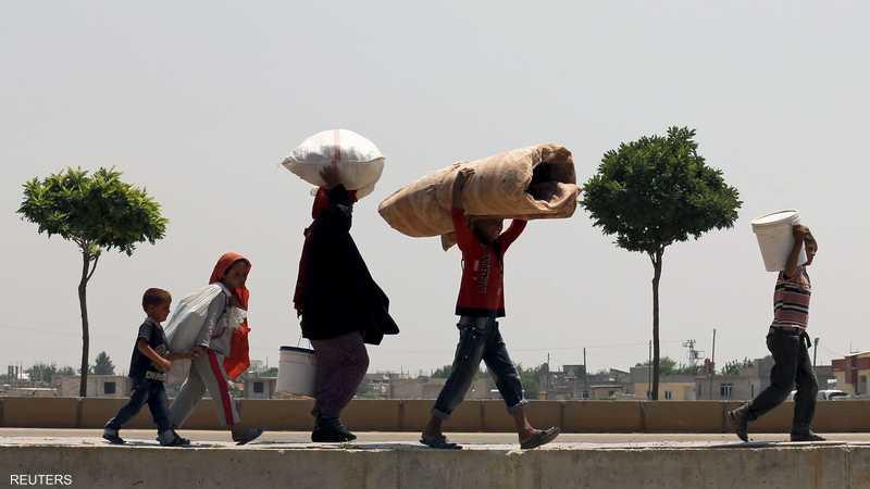 المعارك في تل أبيض أدت إلى نزوح نحو 23 ألف سوري إلى تركيا