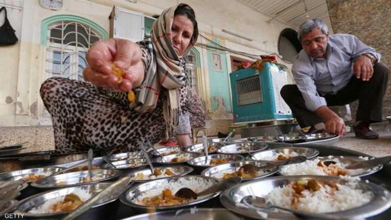 أكراد يجهزون وجبات إفطار مجانية لضيوفهم النازحين واللاجئين من العراق وسوريا