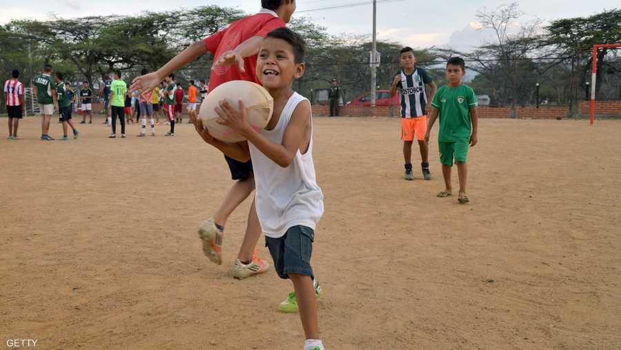 البهجة تنعكس على وجه أحد الأطفال عقب مشاركته في التدريب