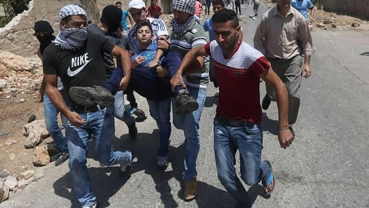 إصابة فلسطينيين جنوب الله اقتحام 1-864895.jpg