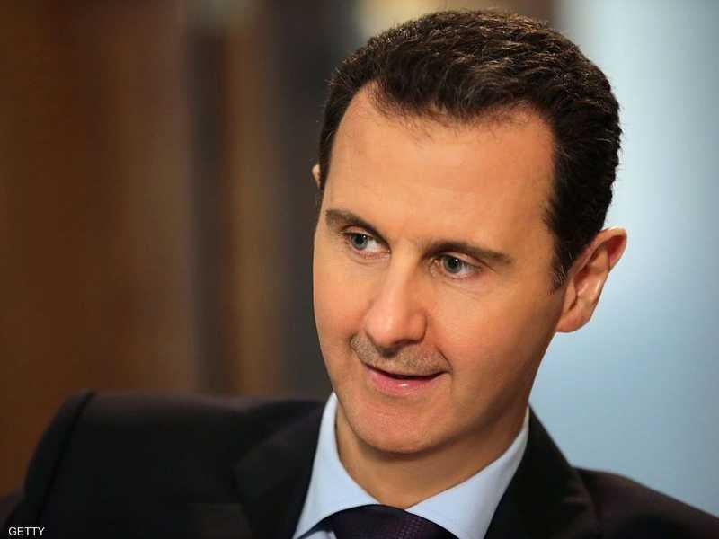 جدل بشأن غياب العلم السوري خلال زيارة الأسد لطهران 1-949153.jpg