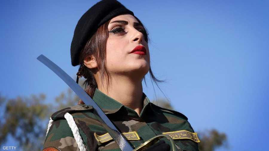 الجمال الكردي بملابس عسكرية