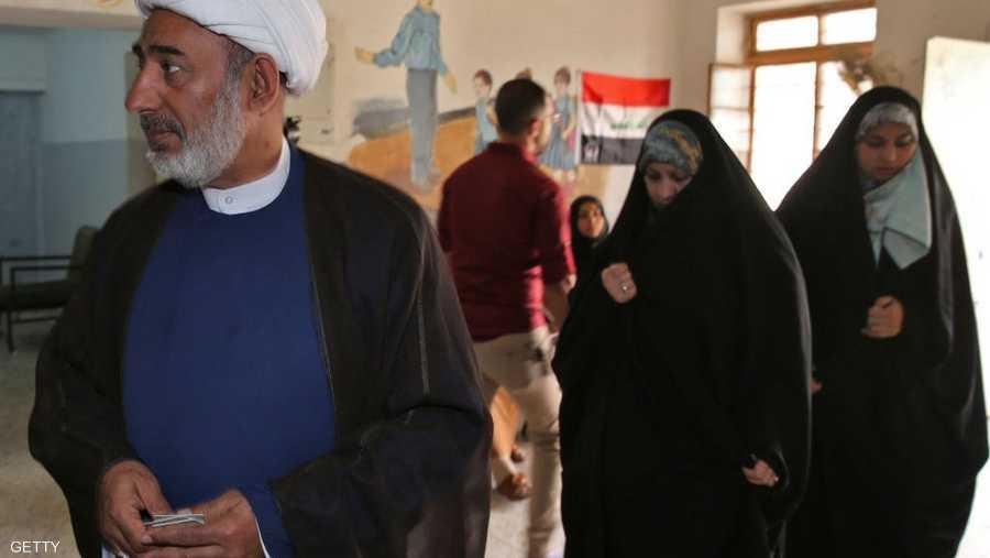 رجل دين قام بالتصويت في منطقة الكرادة ببغداد