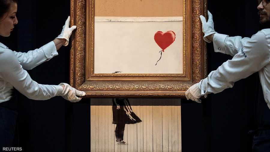 لوحة بانكسي تمزق نفسها ذاتيا بعد بيعها بـ1.4 مليون دولار