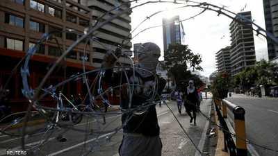 """""""رئيسان"""" لفنزويلا وسط انقسام عالمي.. ونزاع بين البيض والحمر"""