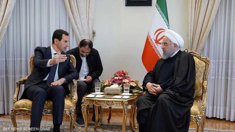 جدل بشأن غياب العلم السوري خلال زيارة الأسد لطهران 1-1230914.jpg