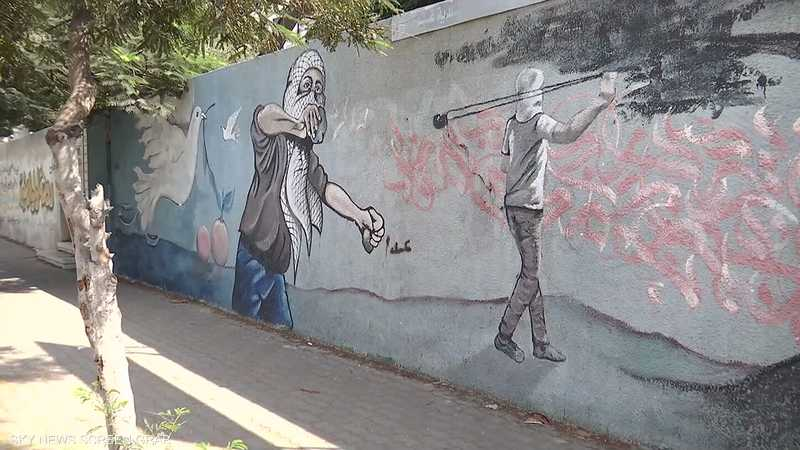 الكتابة على الجدران.. وسيلة إعلام في يد الفلسطينيين