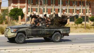 صورة أرشيفية لمسلحين في مدينة طرابلس الليبية