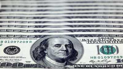 الدولار يهوي أمام العملات لمستوى قياسي