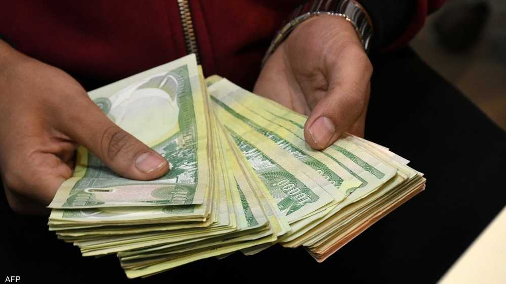 An employee counting cash at an exchange store in Iraq.