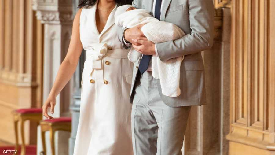 الزوجان وطفلها في قلعة وندسور