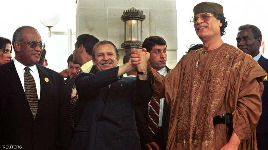 مع الزعيم الليبي الراحل معمر القذافي