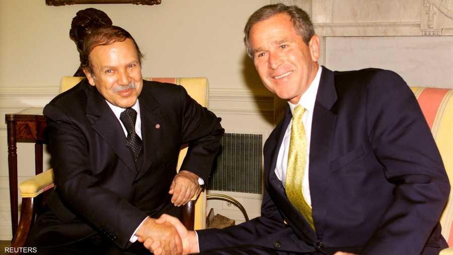 مع الرئيس الأميركي السابق جورج بوش الابن