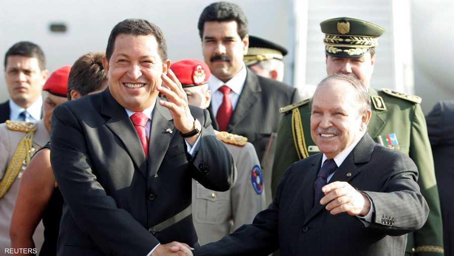 مع الرئيس الفنزويلي الراحل شافيز